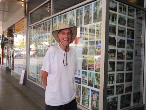 Legendary Wagga artist Arthur Wicks proudly poses alongside his eye-catching installation.