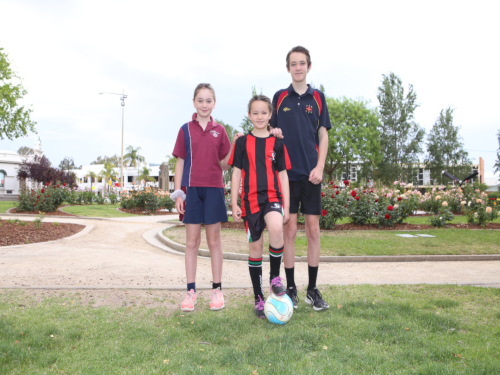 FOOTBALL FANS: Amelia, India and James Illsley are gearing up for Wagga Wagga's historic W-League clash on Sunday 3 November.